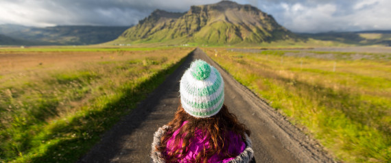 Young woman standing in the road in Iceland.