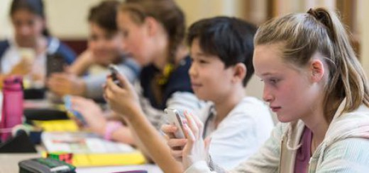 epa05556709 A picture made available on 26 September 2016 shows Students work with smartphones during class in the Friedrich Gymnasium in Freiburg, Germany, 23 September 2016. On 25 September 2016 the project won a 'German Teacher's Award 2016' for innovative lessons in Berlin. Students work out solutions with a smartphone. Scientists are checking whether the project works. It has the character of a federal pilot project.  EPA/PATRICK SEEGER